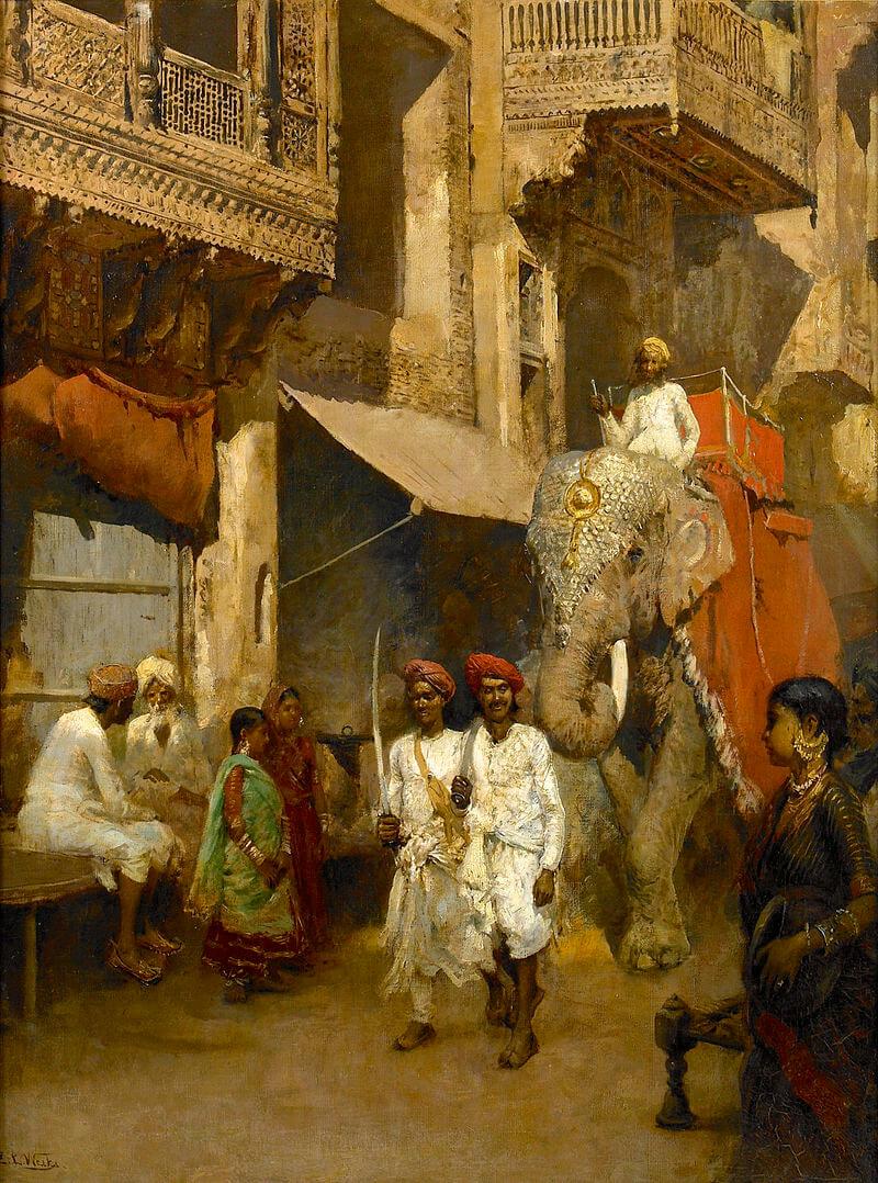 Маратха едет по улице на слоне.