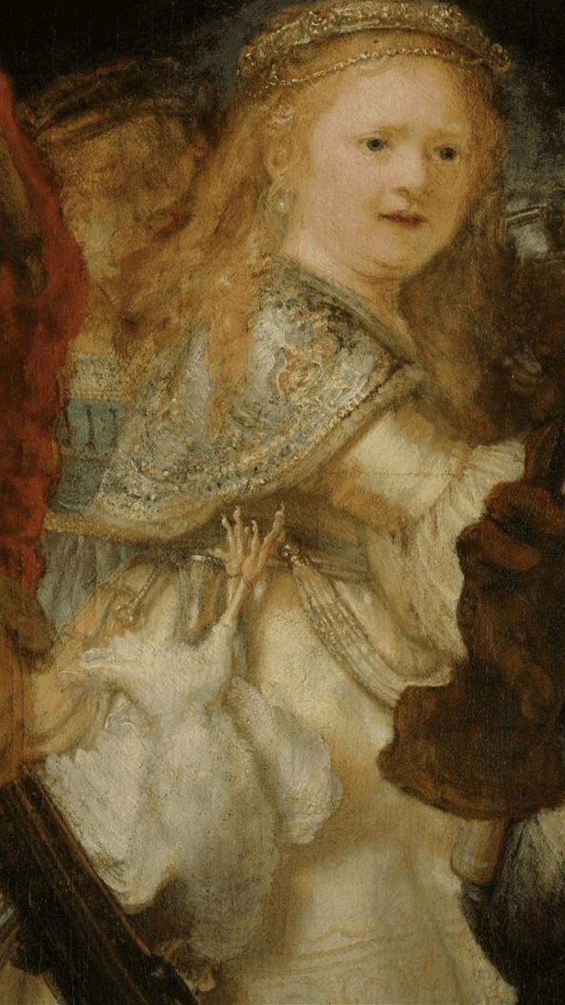 Девочка - самый загадочный персонаж картины. Даже есть мнение, что это последний портрет любимой жены художника Саскии